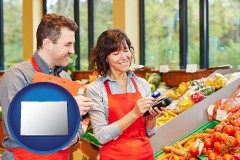 colorado map icon and two grocers working in a grocery store