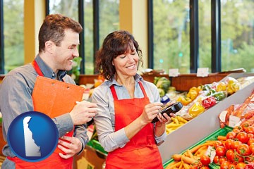 two grocers working in a grocery store - with Delaware icon