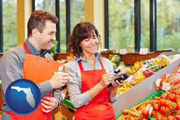 two grocers working in a grocery store - with Florida icon