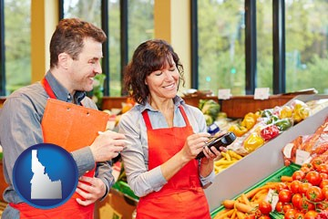 two grocers working in a grocery store - with Idaho icon
