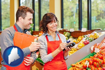 two grocers working in a grocery store - with Maine icon
