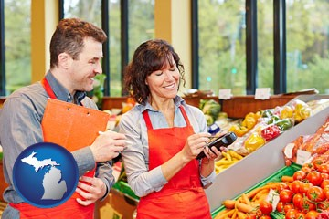two grocers working in a grocery store - with Michigan icon