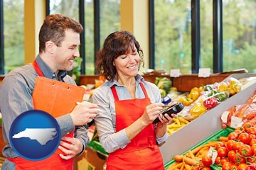 two grocers working in a grocery store - with North Carolina icon