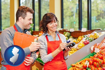 two grocers working in a grocery store - with New Jersey icon