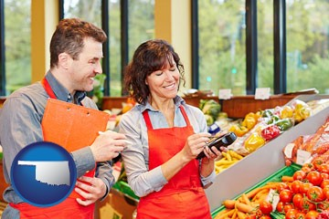 two grocers working in a grocery store - with Oklahoma icon