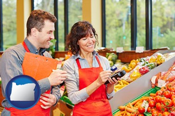 two grocers working in a grocery store - with Oregon icon