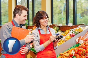 two grocers working in a grocery store - with Vermont icon