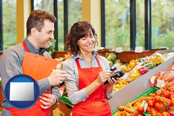 two grocers working in a grocery store - with Wyoming icon